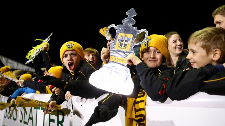 Young Sutton United fans cheer their team