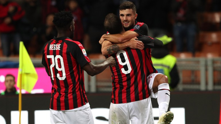 Patrick Cutrone (right) of Milan celebrates with teammates