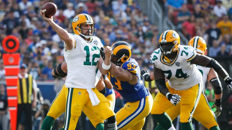Green Bay Packers QB Aaron Rodgers gets a pass away under pressure against the LA Rams