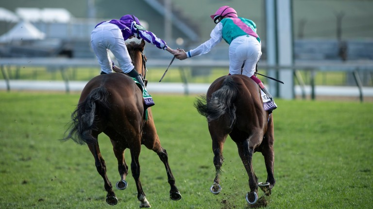 Frankie Dettori (right) is congratulated by Ryan Moore aboard Magical after Enable's success in the Turf