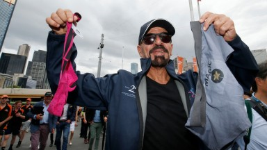 Marwan Koukash at the parade for the Melbourne Cup displays the thong he has threatened to wear if Magic Circle wins the big race