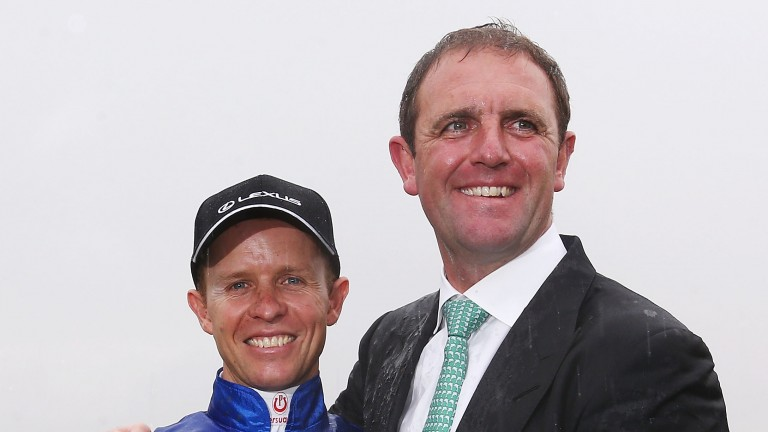 Kerrin McEvoy poses with Charlie Appleby after the Melbourne Cup