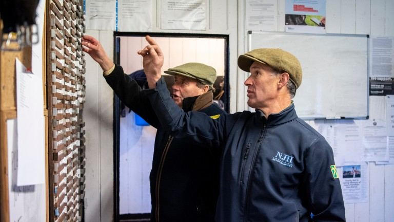 Talking tactics: Henderson and second-in-command Charlie Morlock plan the morning's riding arrangements