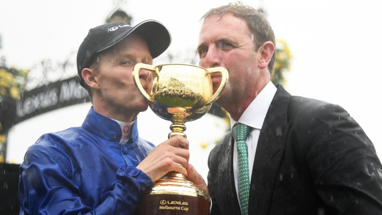 Sealed with a kiss: Charlie Appleby (right) and Kerrin McEvoy, the Melbourne Cup-winning trainer and jockey, savour the moment at Flemington