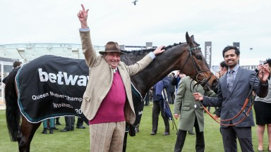 Champions together: champion trainer Nicky Henderson salutes his Champion Chase winner Altior at Cheltenham
