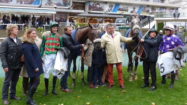 Guillaume Macaire poses with his two star four-year-olds, Master Dino (left) and Tunis, following their one-two finish in the G1 Prix Renaud du Vivier at Auteuil