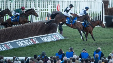 Rather Be lands in second over the last in the Close Brothers Handicap Chase at Cheltenham with winner Mister Whitaker (green with red cap) chasing him