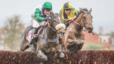 Vinndication (left) jumps a fence alongside Uncle Alastair in the 2m4f novice chase