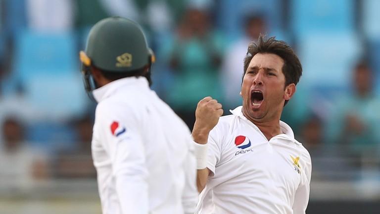 Yasir Shah of Pakistan celebrates after taking the wicket of Usman Khawaja of Australia