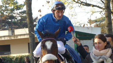 Soon-to-retire Jacques Ricou is interviewed after landing the big race of the day at Auteuil, the Prix Francois de Ganay