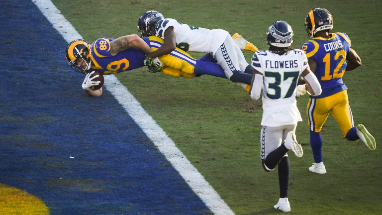 Tyler Higbee of the Los Angeles Rams scores a touchdown against the Seattle Seahawks
