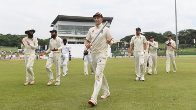 Joe Root leads England off the field after completing a 57-run win in Pallekele