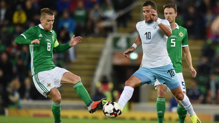 Israel striker Tomer Hemed battles for the ball against Northern Ireland