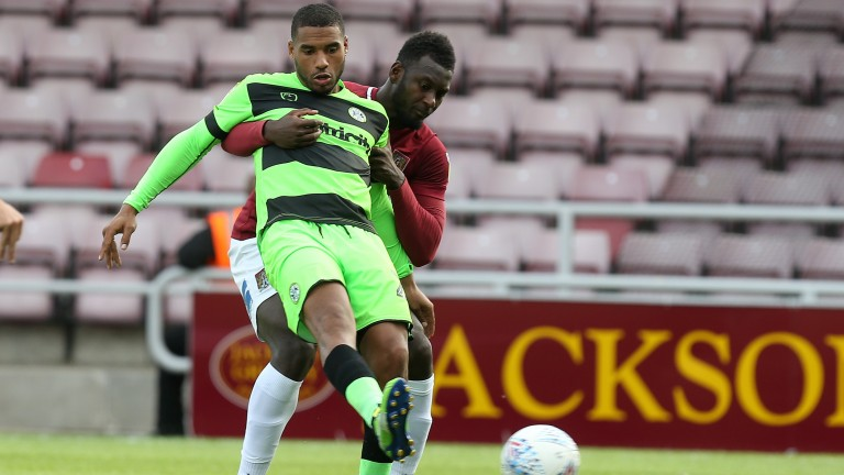 Forest green forward Reuben Reid controls the ball under pressure from Northampton's Aaron Pierre