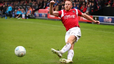 Salford striker striker Adam Rooney has fired in 15 league goals