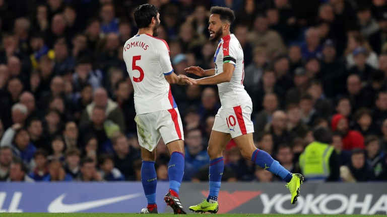 James Tomkins helps Andros Townsend celebrate the Crystal Palace goal at Chelsea