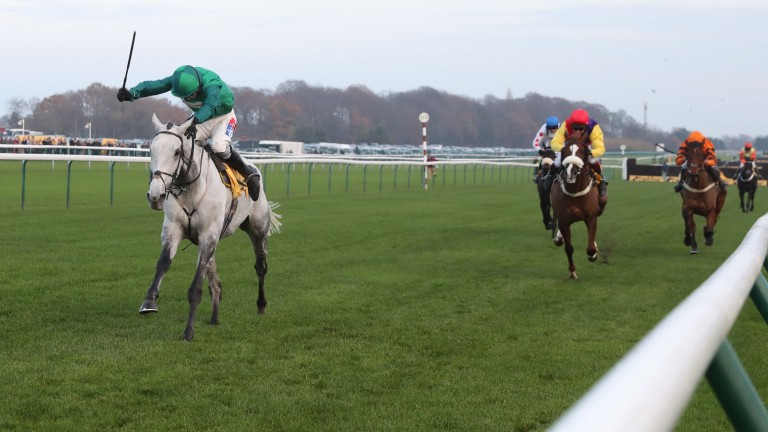Might Bite (right) trails home in the Betfair Chase at Haydock