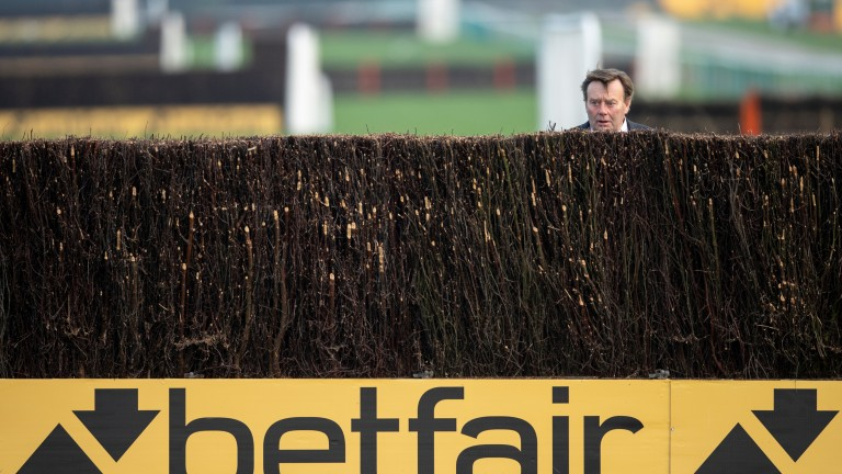 Nicky Henderson takes a look at the final fence before the Betfair Chase