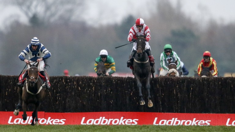 Total Recall (Paul Townend, red) jumps the last before chasing down Whisper (left) to win the 2017 Ladbrokes Trophy at Newbury