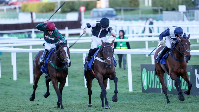Mister Whitaker (Brian Hughes, left) slugs it out with Rather Be (centre) and Rocklander to land the Close Brothers Novices' Handicap Chase at Cheltenham in March