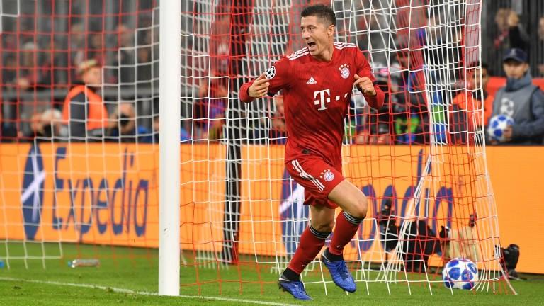 Bayern Munich ace Robert Lewandowski wheels away after scoring against AEK Athens
