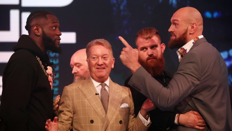 Deontay Wilder (left) and Tyson Fury square up