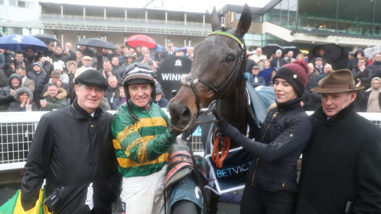 Buveur D'Air and Barry Geraghty in the winner's enclosure with owner JP McManus and his racing manager Frank Berry (right)