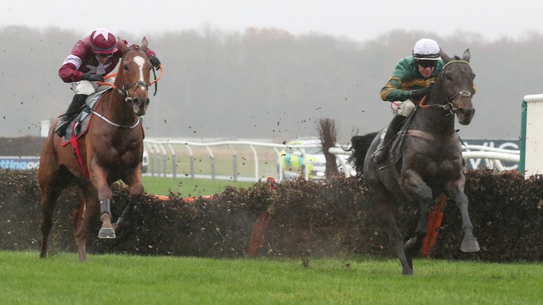 Samcro, left, about to be put in his place by Buveur D'Air in the Fighting Fifth Hurdle at Newcastle