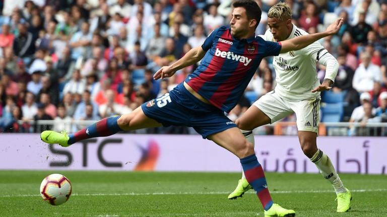 Sergio Postigo of Levante fends off Real Madrid's Mariano Diaz