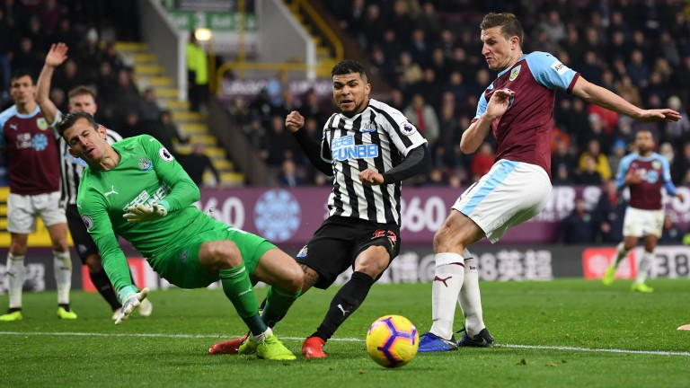 Chris Wood of Burnley takes a shot against Newcastle
