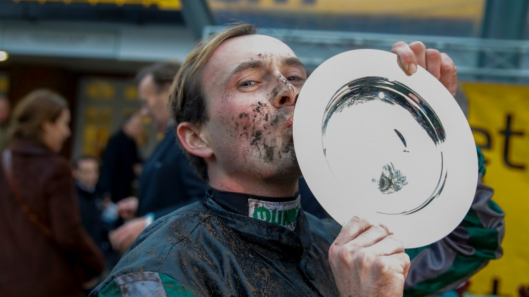 Nico de Boinville Kisses the trophy after Altior winsThe Betfair Tingle Creek Chase (Grade 1)Sandown Pk  8/12/2018©cranhamphoto.com