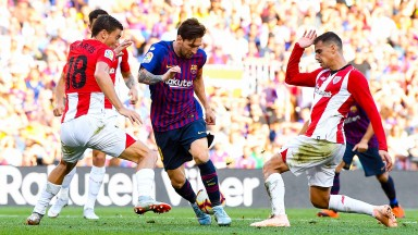 Athletic Bilbao players struggle to stop Leo Messi
