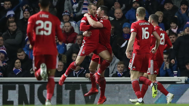 Aberdeen celebrate their goal in the recent win over Rangers at Ibrox