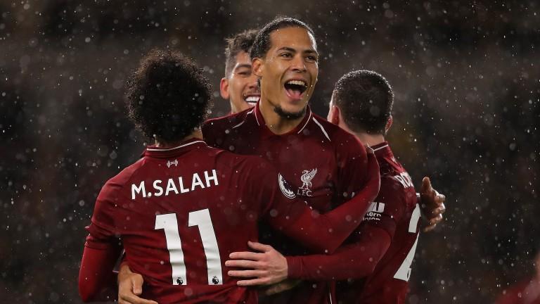Liverpool aces Mohamed Salah and Virgil van Dijk celebrate a goal