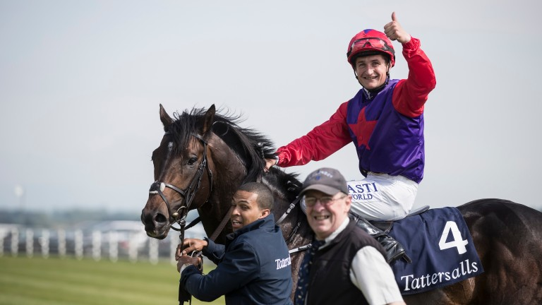 Shane Foley gives a thumbs-up after landing the Irish 2,000 Guineas on Romanised