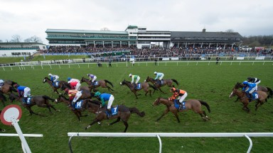 Last year's Coral Welsh Grand National field start the last circuit with winner Raz De Maree (James Bowen in blue, no9) towards the rear