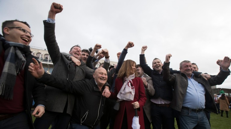 The Poor Man's Syndicate celebrate The Church Gate's win in the Irish Daily Star Christmas Handicap Hurdle at Leopardstown