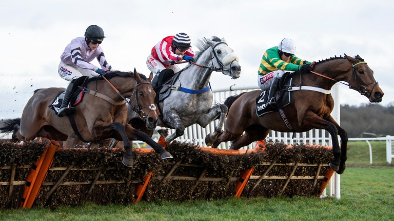 Champ (Barry Geraghty, right) jumps the final flight to beat Kateson (centre) and Getaway Trump in the Challow Hurdle