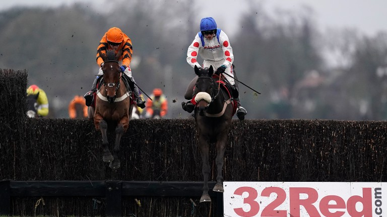 Clan Des Obeaux (right) heads Thistlecrack at the last in the King George at Kempton