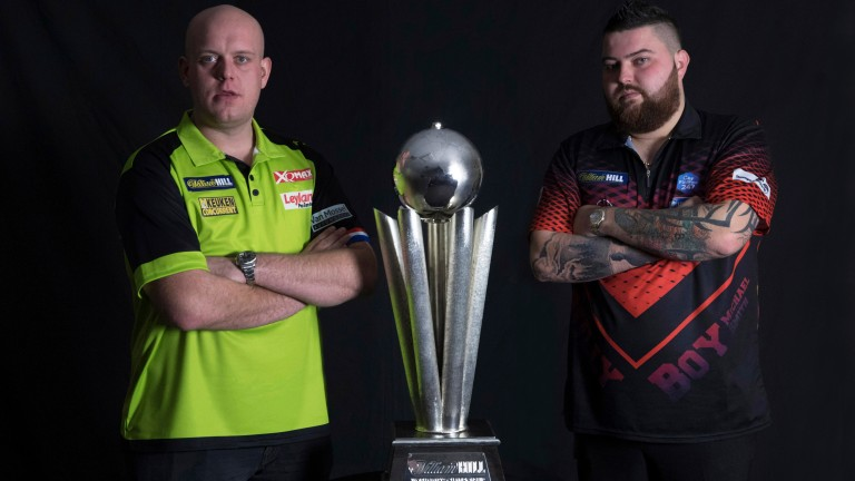 Alexandra Palace finalists Michael van Gerwen and Michael Smith with the trophy