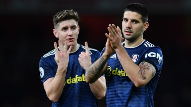 Tom Cairney (left) and Aleksandar Mitrovic (right) will be hoping they can guide Fulham to safety