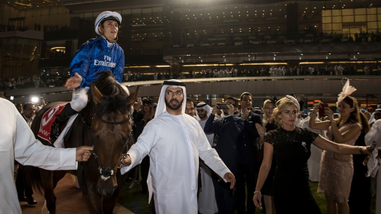Saeed bin Suroor leads Thunder Snow and Christophe Soumillon in after winning the Dubai World Cup