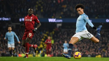 Leroy Sane fires Man City into a 2-1 lead against Liverpool