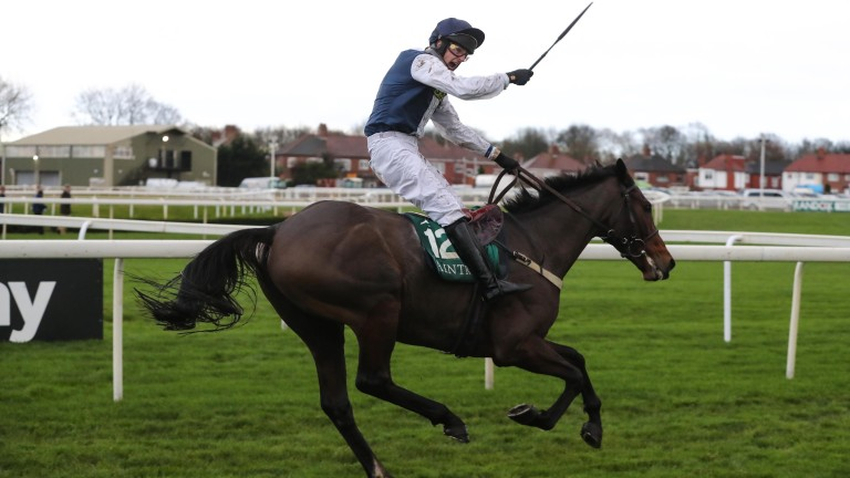 James Best celebrates winning the Becher Chase on Walk In The Mill