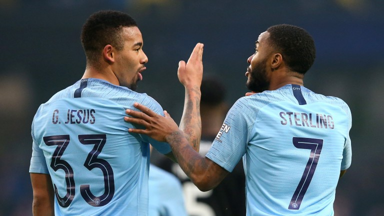 Gabriel Jesus chats with Manchester City teammate Raheem Sterling