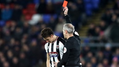Andrew Fox of Grimsby is sent off by referee Mark Atkinson