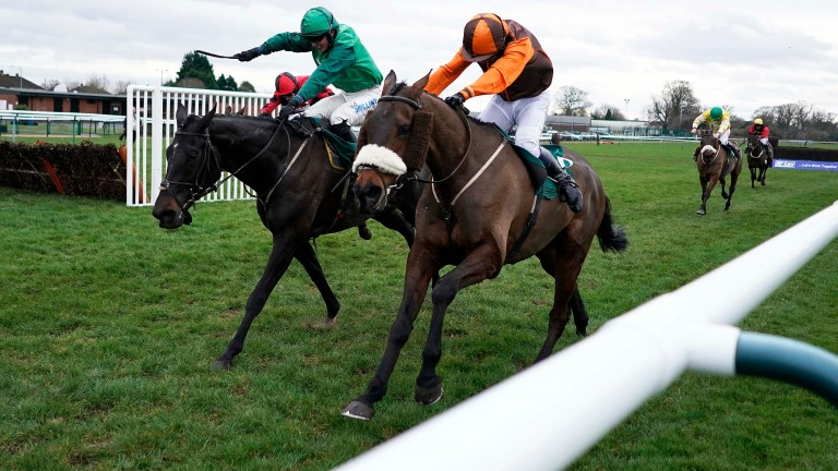 Impulsive Star and Sam Waley-Cohen (right) outbattle Calett Mad to land the Classic Chase at Warwick