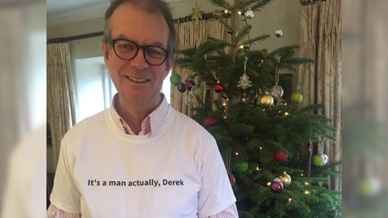 Bob Cooper wearing a specially made T-shirt presented to him by his daughter