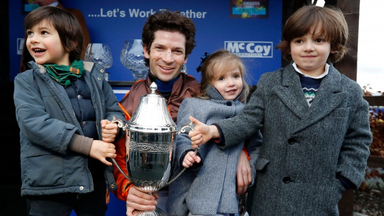 Sam Waley-Cohen with his children Max and Charlotte and nephew Robert (left) after winning the Classic Chase with Impulsive Star