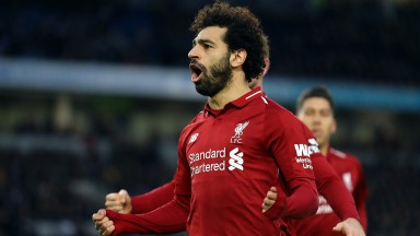 Mohamed Salah celebrates the penalty that gave Liverpool a vital win at Brighton